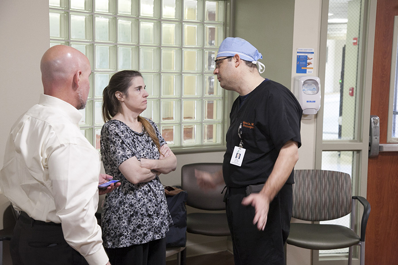 Dr Ziu talks with patient's family
