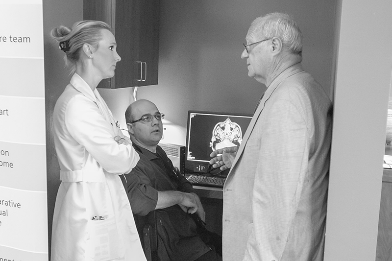 Dr Ziu consults with colleagues