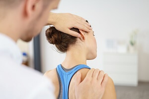 Doctor Examines Girl, Neck Pain