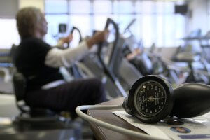 older woman exercising in gym