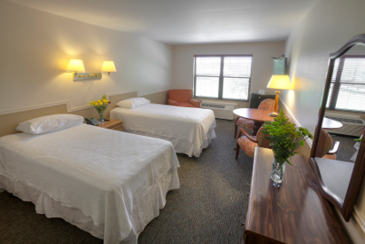 Standard room with two twin beds and private bathroom.