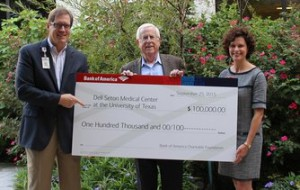 Nikki Graham (right), Austin president, Bank of America, presents check to Pete Winstead (center), chair of the capital campaign for Dell Seton Medical Center at UT, and Charley Scarborough, executive director of development for Dell Seton Medical Center at UT.