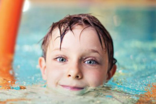 child swimming in water