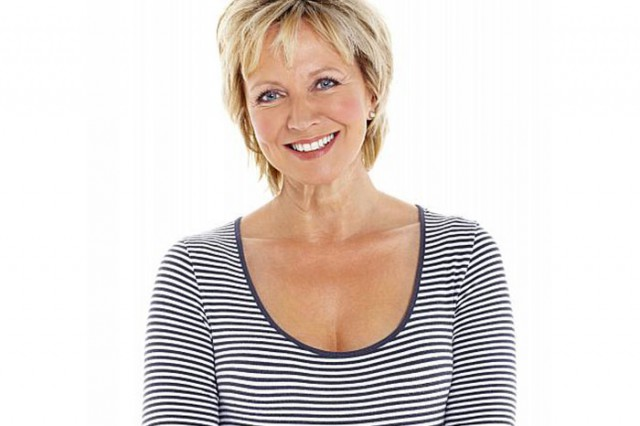 smiling older woman in striped shirt