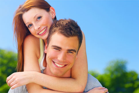 happy smiling young couple hugging