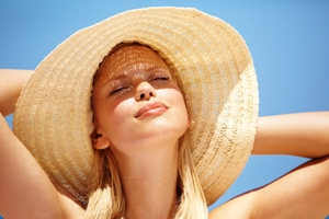 woman in hat squinting at sun