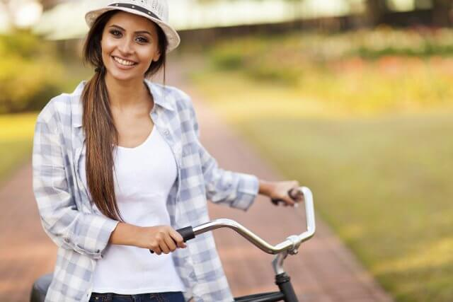 woman with bicycle outside
