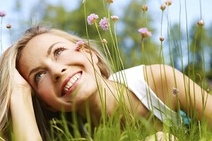 happy woman outside smiling