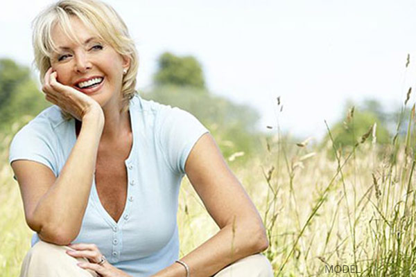 mature woman outside smiling