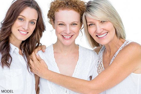 smiling mature mother with adult daughters