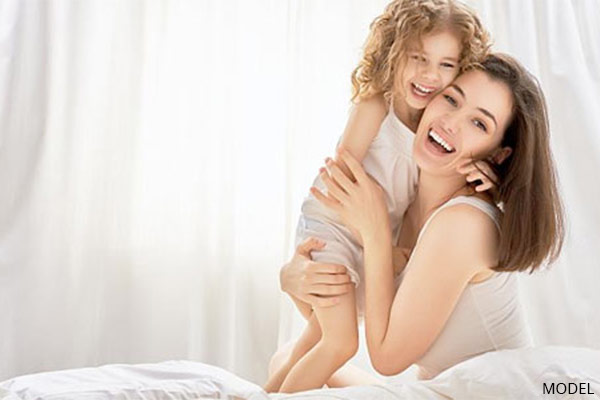 mother and toddler daughter hugging