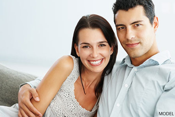 smiling couple on couch