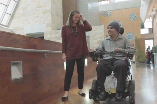 teen in wheelchair with therapist