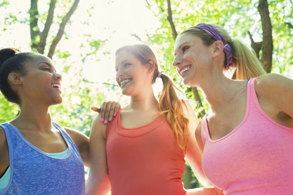 happy women exercising together