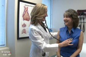 woman getting heart health exam