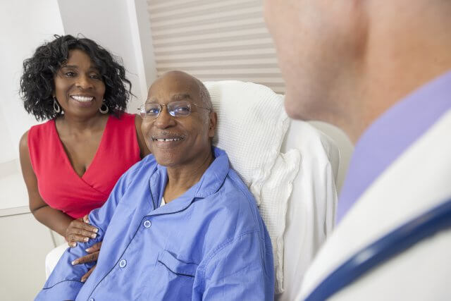 senior african american couple in hospital room