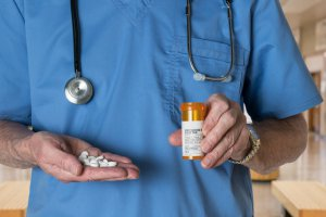 doctor holding prescription pills