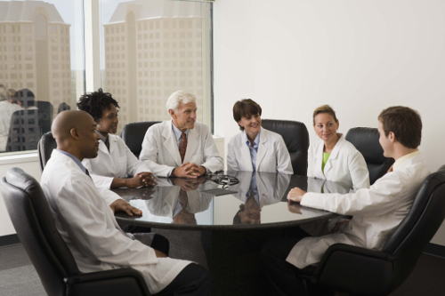 doctors talking at conference table